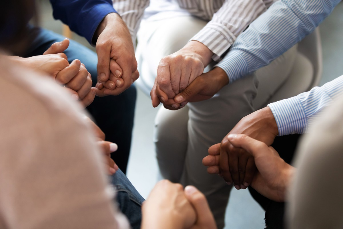 Holding Hands in healing circle
