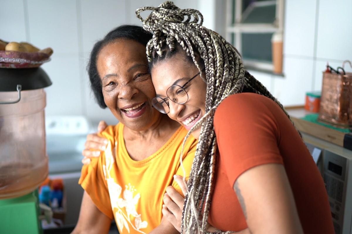 Smniling elderly African American woman and young woman